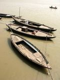 Three Wooden Boats Floating on the Water. royalty free stock photography