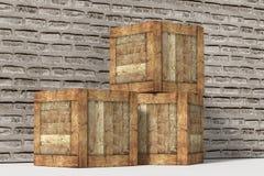 Three wooden boxes near brick wall Stock Photography
