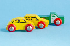 Three wooden cars toys on azure background Stock Photo