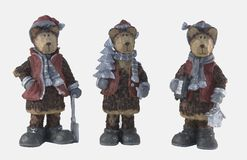 Three Wooden Christmas Bears. Each representing a different aspect of the season Royalty Free Stock Images