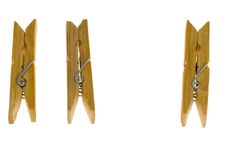 Three wooden clothes-pegs Stock Image
