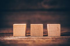 Wooden Cubes on Wood Background royalty free stock images