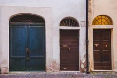 Three wooden doors in buildings. In Rome, Italy stock photos