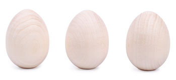 Three wooden Easter eggs isolated on a white Royalty Free Stock Photos