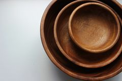 Three wooden empty food bowls stacked on top of each other royalty free stock photo