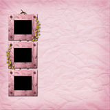 Three wooden frameworks for photo. On the crumpled pink paper Royalty Free Stock Photos