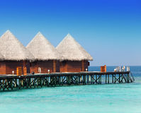 Three wooden houses against the ocean Stock Photos