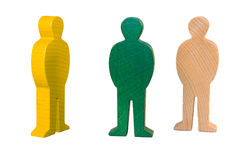 Three wooden mannequins. Three small identically sized and shaped mannequins all standing Stock Photography