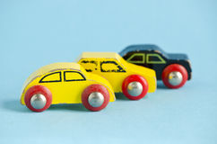 Three wooden and old car toys Royalty Free Stock Images