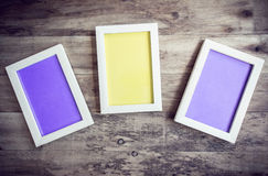 Three wooden photo frame on old wooden wall Royalty Free Stock Photos
