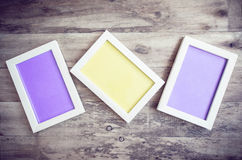 Three wooden photo frame on old wooden wall Stock Image