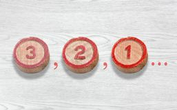 Three Wooden Pieces Depicting the Countdown from Three to One Stock Photos