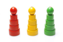 Three wooden pyramids. Toy on white background Stock Image