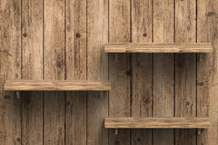 Three wooden shelves on wall Royalty Free Stock Images