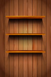 Three wooden shelves on the wooden background Stock Photo