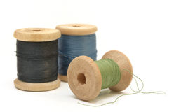 Three wooden spools of thread Royalty Free Stock Photos