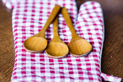 Three Wooden spoons  on checkered red dishtowel Royalty Free Stock Image