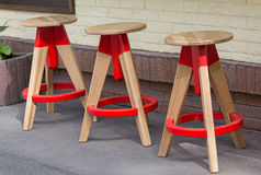 Three wooden stool in a modern style street cafe Royalty Free Stock Photo