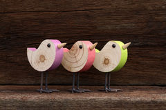 Three Wooden Toy Birds Decoration Rough Background Royalty Free Stock Image