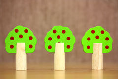 Three wooden toy trees Royalty Free Stock Photos