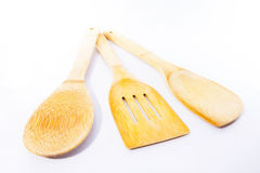 Three wooden utensils for the kitchen. Over white background Royalty Free Stock Images
