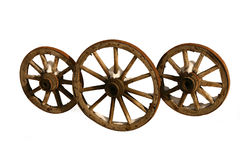 Three wooden wheels. Three wooden wheels from a cart on a white background Royalty Free Stock Images