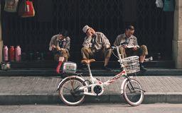 SHANGHAI, CHINA: Three workers break time, resting. Three workers break time, resting royalty free stock photography