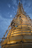 Three workers cleaning the gigantic golden stupa. Inside Saket temple in Bangkok in June 23, 2017 Royalty Free Stock Photos