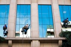 Three workers cleaning windows. Sao Paulo, Brazil, January 31, 2015. Three workers cleaning windows of a commercial building on January 31, 2015 in Sao Paulo Stock Photo