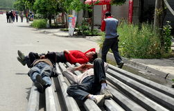 Pengzhou, China: Workers Taking Nap Royalty Free Stock Images