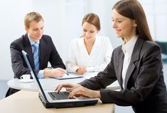 Three working businesspeople Stock Image