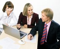 Three working businesspeople Royalty Free Stock Photography
