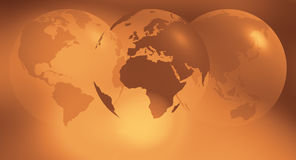 Three world globes gold abstract background. World globe on abstract defocused background Royalty Free Stock Photos