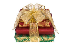 Three Wrapped Gift Boxes With Gold Ribbon And Bow Royalty Free Stock Image
