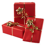 Three wrapped presents. Close up of three presents in red wrapping paper, isolated on white background with clipping path royalty free stock photos