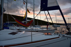 Three yachts anchoring in bay at sunset Royalty Free Stock Images