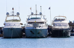 Three yachts on docks of port Mandraki Rhodes Greece Stock Photo