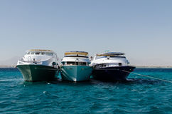 Three yachts in the sea Stock Photos
