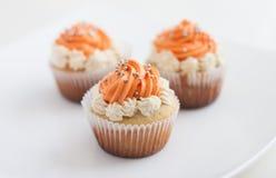 Three Orange Cupcakes with Buttercream. Three yammy orange Cupcakes with Buttercream Stock Image