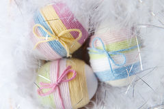 Yarn wrapped Easter eggs Stock Photos