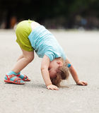 Three-year chid upside down. In park Stock Photography