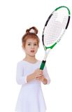 Three-year girl with a tennis racket in hand Stock Image