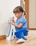 Three year old baby playing with electric iron Stock Photos
