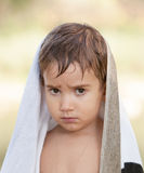 Three year old boy with a serious expression Stock Photo
