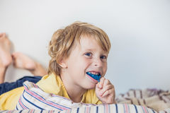 Three-year old boy shows myofunctional trainer to illuminate mouth breathing habit. Helps equalize the growing teeth and correct. Bite. Corrects the position of stock images