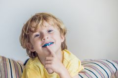 Three-year old boy shows myofunctional trainer to illuminate mouth breathing habit. Helps equalize the growing teeth and correct b. Ite. Corrects the position of stock image
