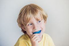 Three-year old boy shows myofunctional trainer to illuminate mouth breathing habit. Helps equalize the growing teeth and. Correct bite. Corrects the position of royalty free stock photos