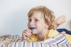 Three-year old boy shows myofunctional trainer to illuminate mouth breathing habit. Helps equalize the growing teeth and correct. Bite. Corrects the position of royalty free stock photography