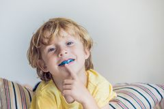 Three-year old boy shows myofunctional trainer to illuminate mouth breathing habit. Helps equalize the growing teeth and correct b. Ite. Corrects the position of Stock Images