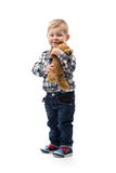 Three year old boy with a toy bear on white background Royalty Free Stock Photos
